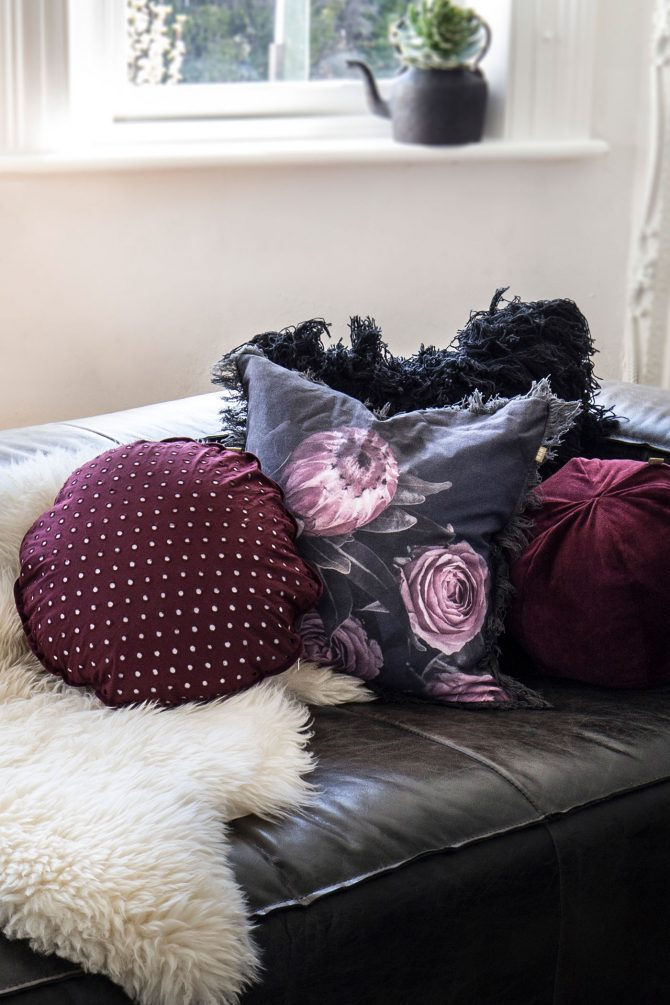 floral cushion on a couch with other matching cushion
