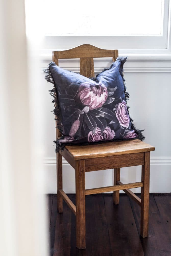 floral print cushion on kitchen chair