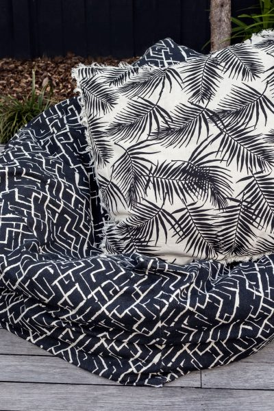Raine and Humble tribal print bean bag on wooden deck