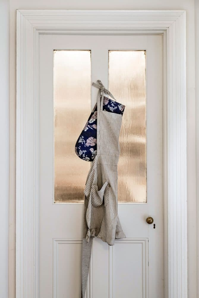 Striped apron hanging on a kitchen door