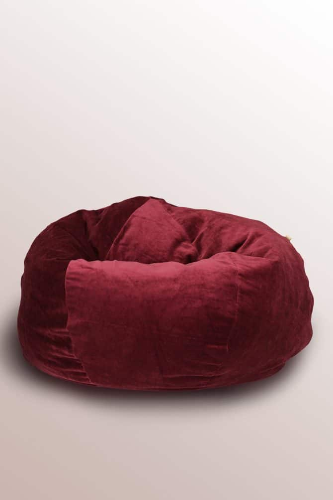ruby-red-velvet-ottoman-on-the-floor
