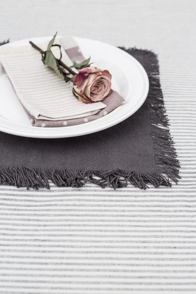 striped-table-cloth-with-charcoal-placemat-on top