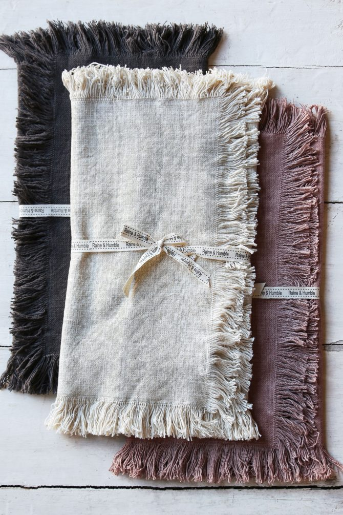folded table runners on bench in three colours