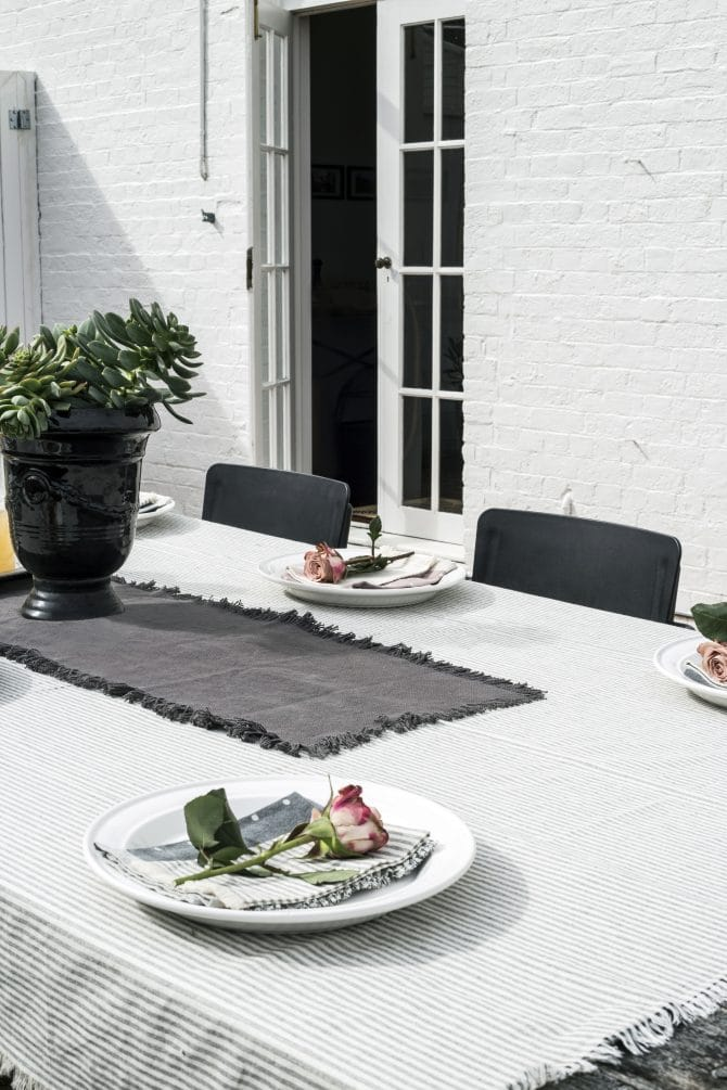 outdoor-table-set-with-striped-tablecloth