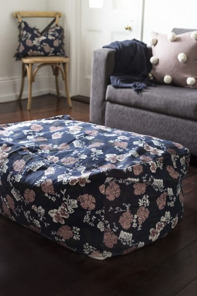 navy-beanbag-with-rose-print-on-lounge-room-floor