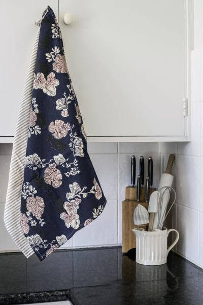 rose-print-tea-towel-hanging-from-kitchen-cupboard-handle