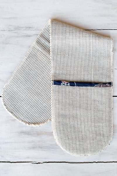 striped oven glove flat on bench