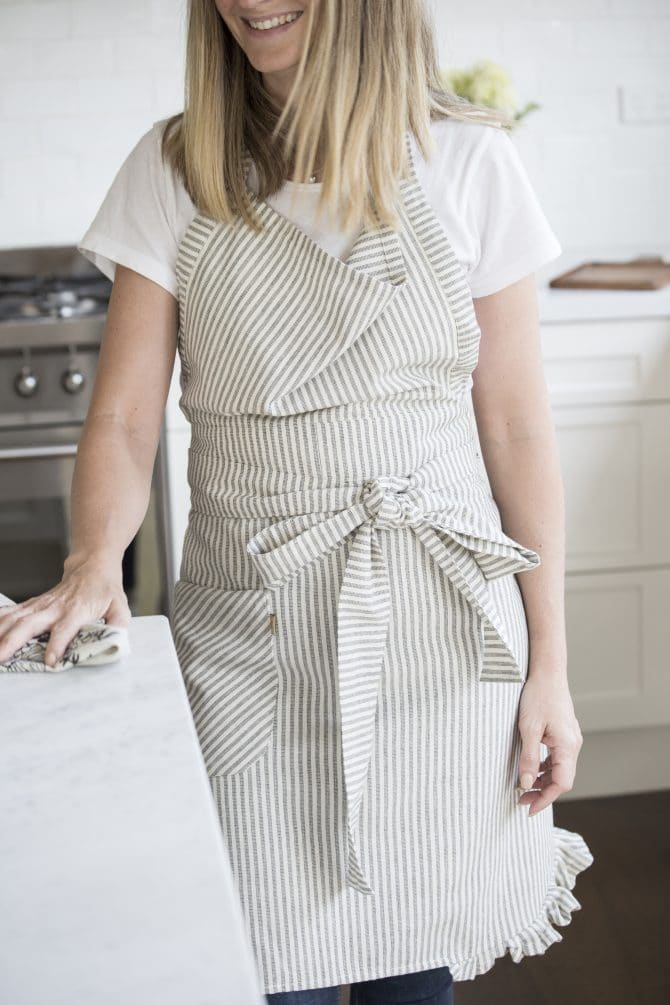 lady-wearing-fine-striped-apron-in-kitchen