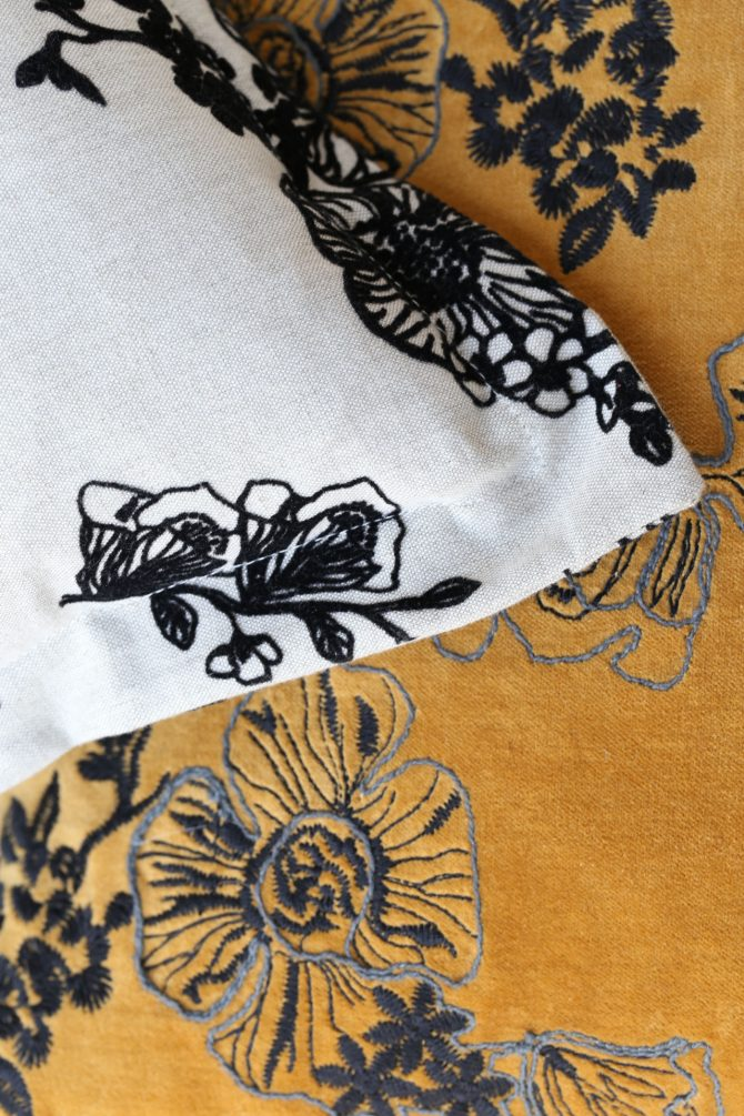 embroidered mustard cushion